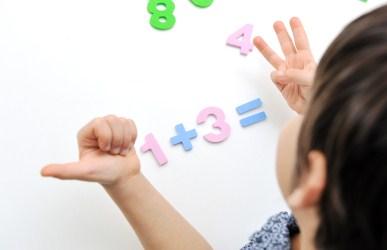 child doing math problem