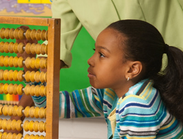 student doing math on abacus