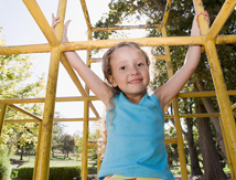 Young girl on jungle gym