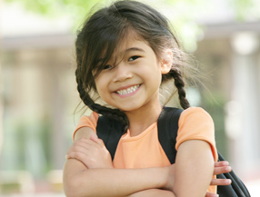 Smiling girl wearing backpack