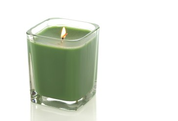 Lit green candle