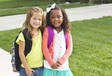 Two little girls walking to school