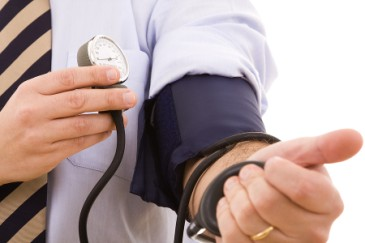 Keeping Your Husband Healthy, Man checking his own blood pressure to stay healthy