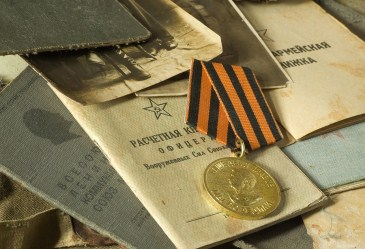 Pile of old army documents and passports