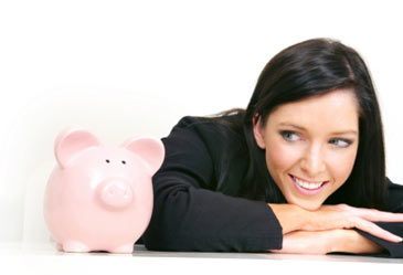 woman looking patiently looking at piggy bank