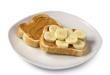 Toast topped with peanut butter and banana