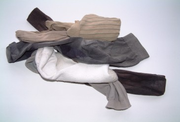 Pile of sock and laundry against white background