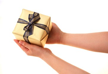Holding a small wrapped gift box
