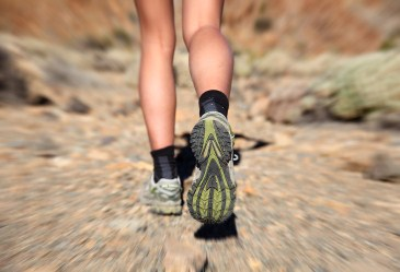 Close up of woman's running shoes on outdoor trail