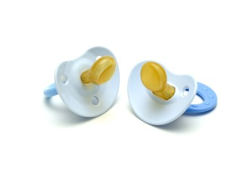 Two blue pacifiers against white background