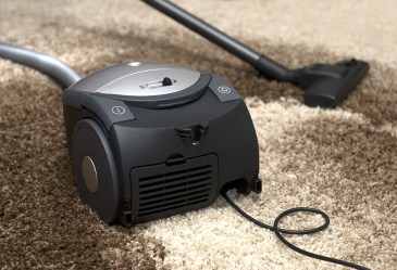 Vacuum on top of dirty carpet