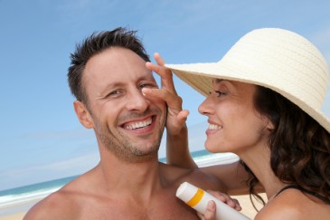 Keeping Your Husband Healthy, Woman putting sunscreen on man for cancer prevention