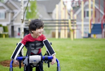 Young happy boy in wheelchair