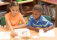 Boy and girl working on math problem