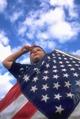 Boy saluting American flag