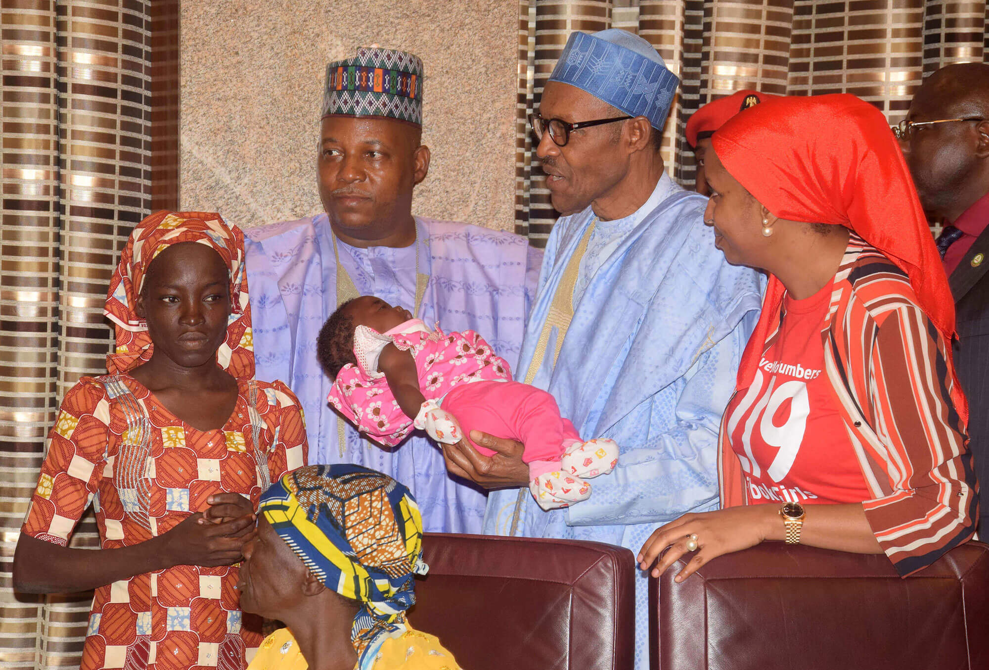 picture of Amina Ali, one of the found schoolgirls with President Muhammadu Buhari