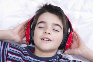 boy listening to relaxing music
