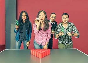 image of college students playing beer pong