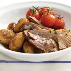 Roast Lamb with Cherry Tomatoes and Thyme photo