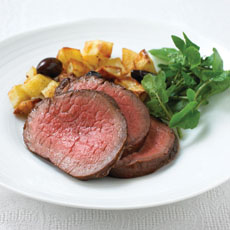 Glazed Fillet of Beef Roasted with Potatoes and Olives photo