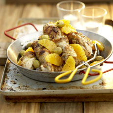 Grilled Chicken Drumsticks with Oranges and Green Olives photo