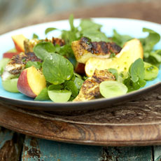 Grilled Curry Chicken with Watercress, Grapes, Peaches, and Orange-Red Wine Vinaigrette photo
