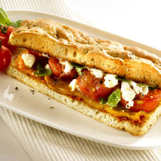 Focaccia Sandwich with Tomatoes and Peppers photo