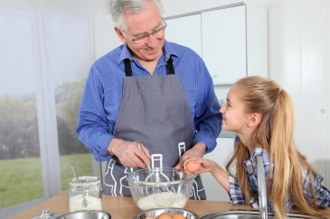 grandparent, grandchild cooking together