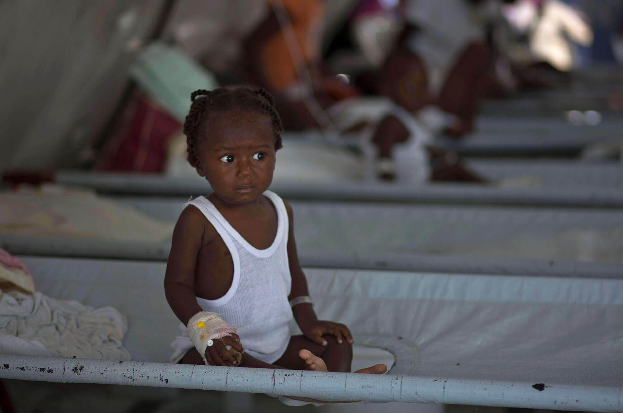 Image of A girl in the hospital receiving treatment for cholera symptoms
