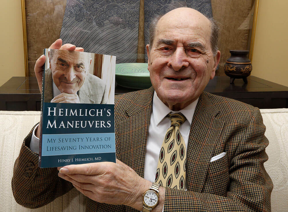 Image of Heimlich with his book