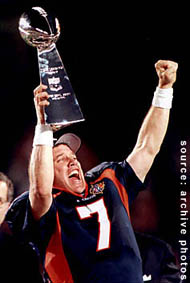John Elway holding aloft the Vince Lombardi Trophy