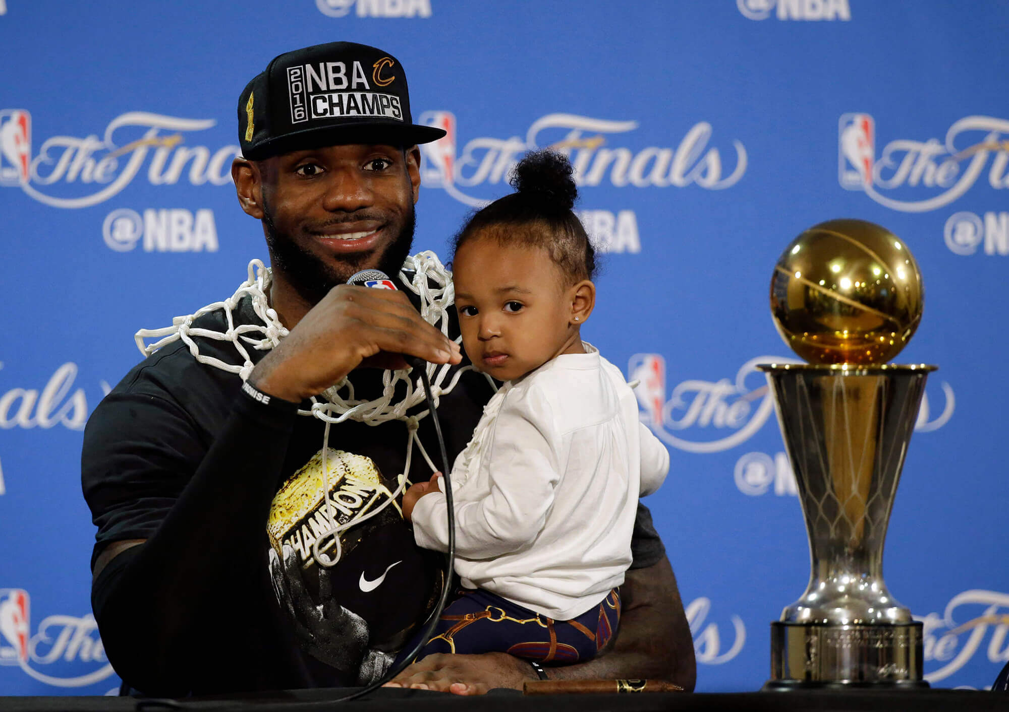 LeBron James with his daughter and the MVP trophy