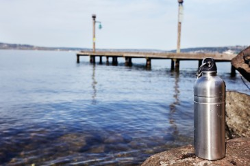 Summer camp essentials, reusable water bottle near beach