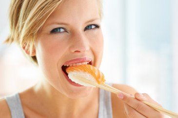 me time idea, woman eating sushi