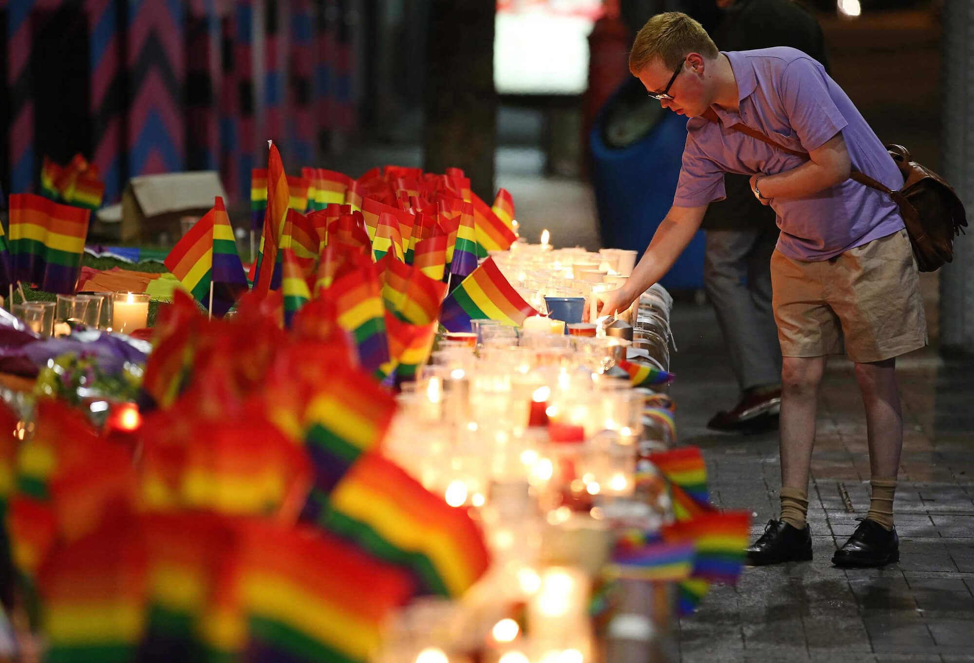 LGBT+ flags with candles as a memorial to the victims of the Orlando mass shooting