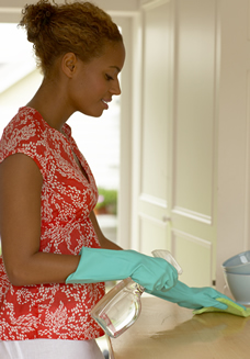 Pregnant woman cleaning kitchen cabinets