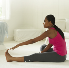 woman doing prenatal leg stretch