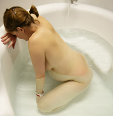 pregnant woman in birthing pool or tub