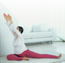 pregnant woman in stretched arm yoga pose