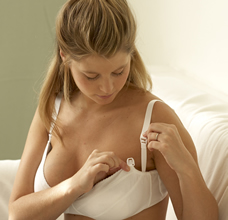 Pregnant woman adjusting bra