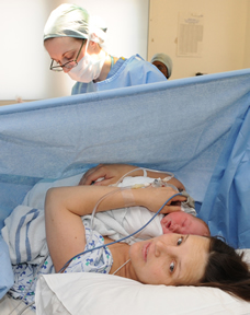 Woman getting cesarean section