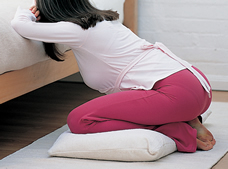 Pregnant woman kneeling on floor