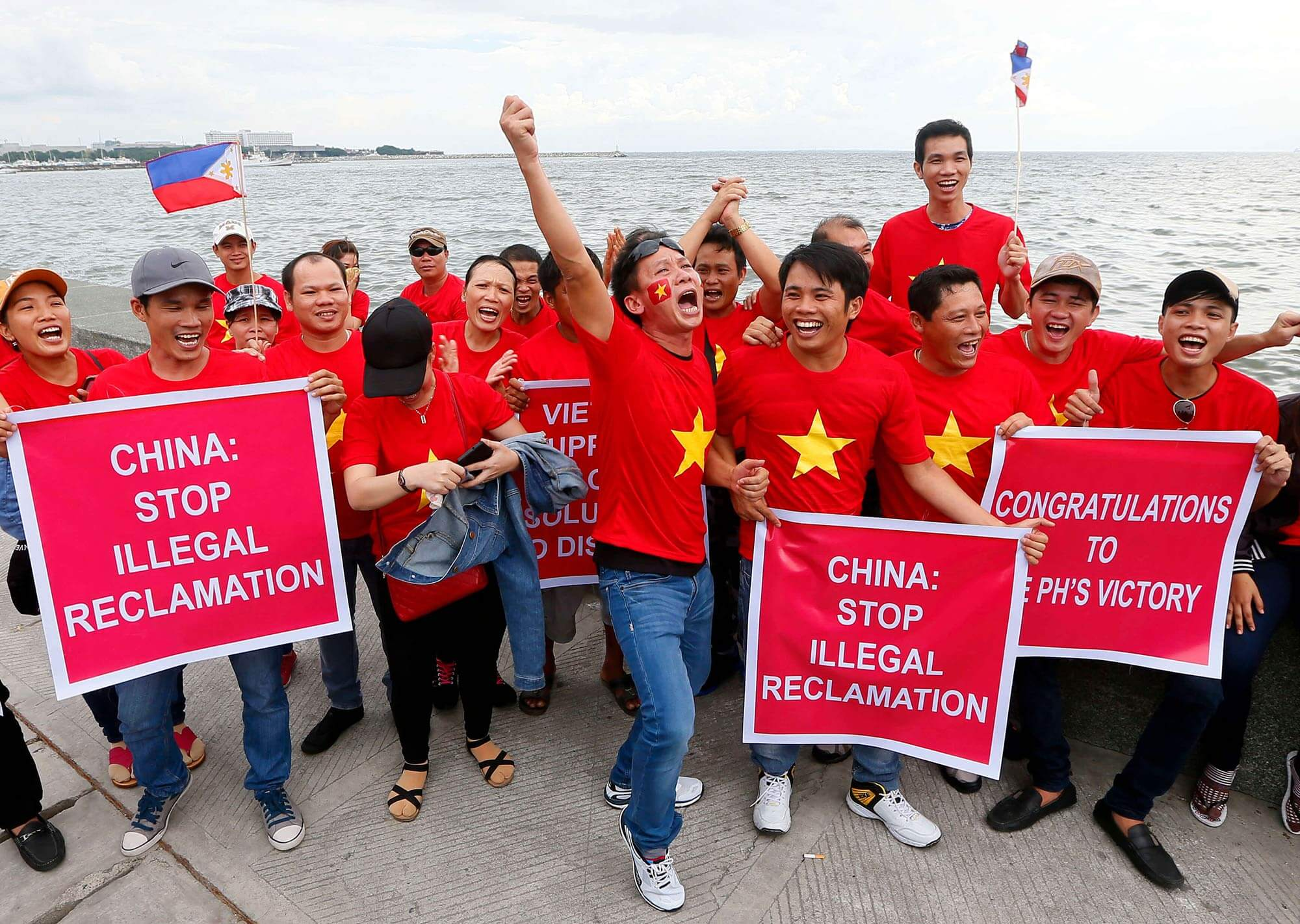 Image of protestors protesting china's attempt to reclaim the sea