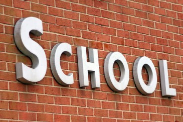 End of School Year, school building with sign