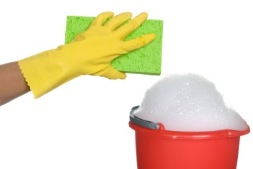 Fundraising ideas, hand in rubber glove with sponge and bucket