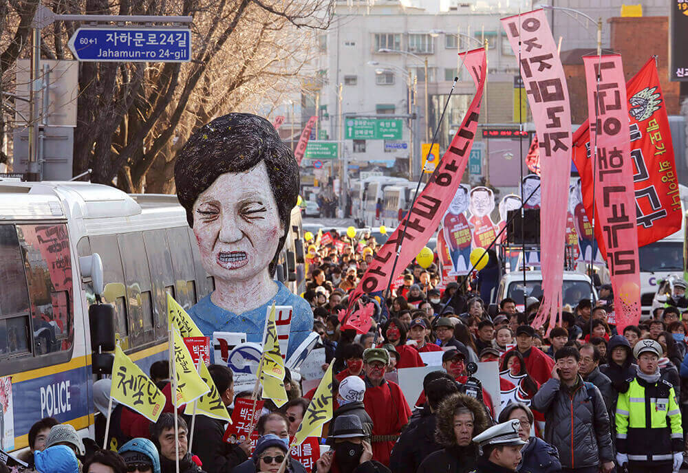 Image of protesters with an effigy of South Korean President Park Geun-hye