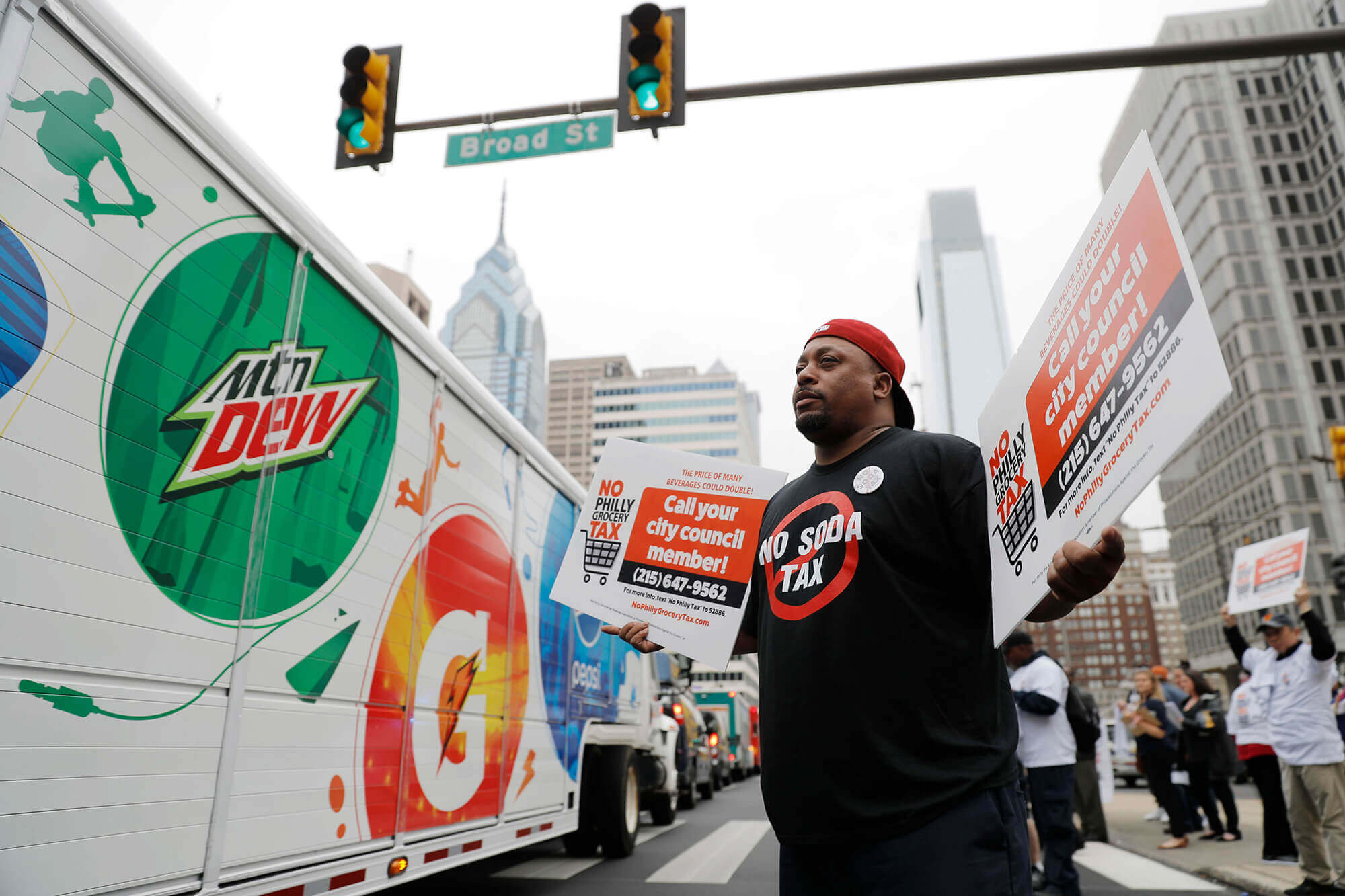 Image of man outside of Philadelphia city hall protesting the soda tax.