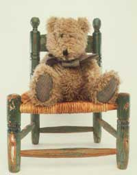 teddy bear on chair