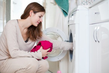 teen girl doing laundry