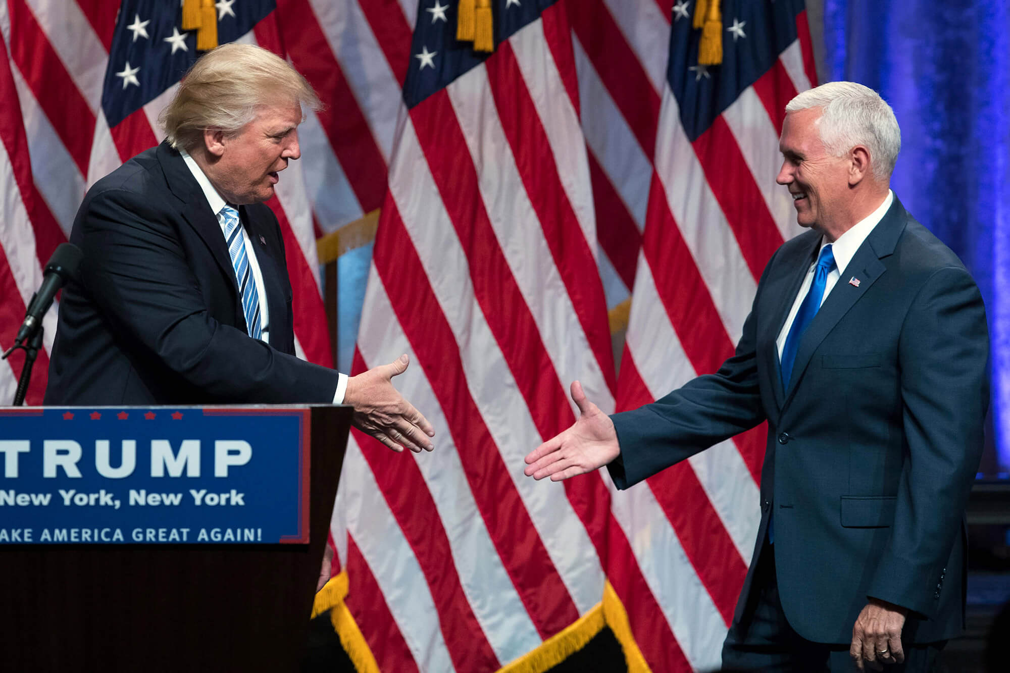 Image of Trump about to Shake Pence's hand.